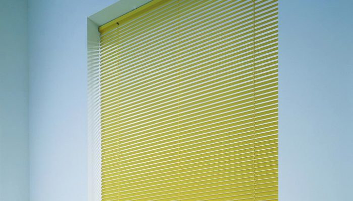metal-venetian-blinds-yellow-tablet