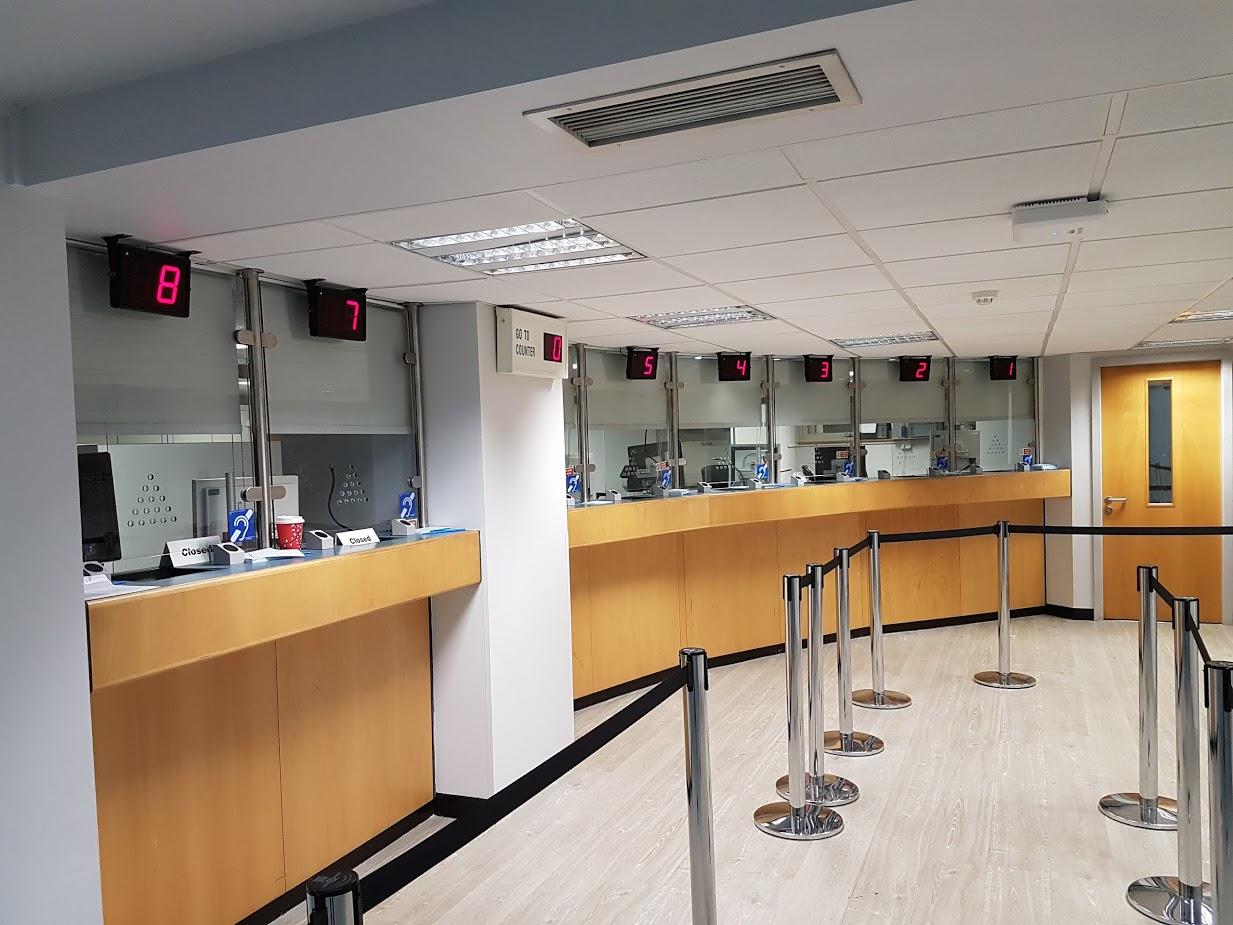 Roller Blinds Installed At Cashier Desks In London